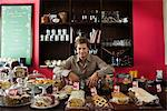 Cafe owner, assorted pastries and baked goods on counter Stock Photo - Premium Royalty-Free, Artist: Cultura RM, Code: 695-05780151