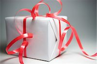 present wrapped close up - Gift wrapped in ribbon, close-up Stock Photo - Premium Royalty-Freenull, Code: 696-05780731