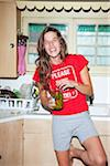 Woman eating Pickles in Kitchen