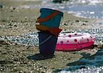 Buckets and inflatable ring on beach Stock Photo - Premium Royalty-Freenull, Code: 696-05780925