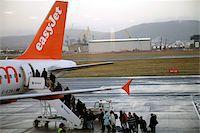 Easyjet passengers boarding at Belfast City airport, Belfast, Ulster, Northern Ireland, United Kingdom, Europe Stock Photo - Premium Rights-Managednull, Code: 841-05781085