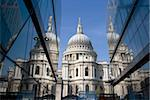 The dome of St. Paul's Cathedral reflected in glass walls, London, England, United Kingdom, Europe