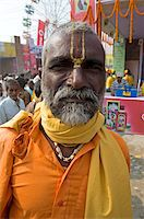 Bihari villager, a Vishnaivite devotee with tilak on his forehead indicating the Hindu god Vishnu, wearing orange clothing for visit to the Vishnu temple at Sonepur Cattle Fair, near Patna, Bihar, India, Asia Stock Photo - Premium Rights-Managednull, Code: 841-05785478