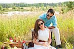Couple having Picnic, Unionville, Ontario, Canada Stock Photo - Premium Royalty-Free, Artist: Ikonica, Code: 600-05786058