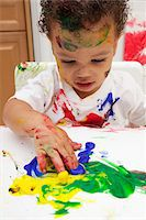 finger painting - messy toddler fingerpainting Stock Photo - Premium Royalty-Freenull, Code: 600-05786120