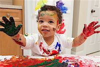 finger painting - Little Boy Finger Painting Stock Photo - Premium Royalty-Freenull, Code: 600-05786122