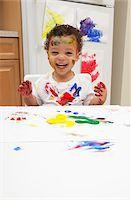 finger painting - Little Boy Finger Painting Stock Photo - Premium Royalty-Freenull, Code: 600-05786124
