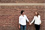 Portrait of Young Couple Standing in front of Brick Wall Stock Photo - Premium Royalty-Free, Artist: Ikonica, Code: 600-05786144