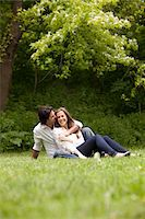 Young Couple Sitting on Grass in Park Stock Photo - Premium Royalty-Freenull, Code: 600-05786146