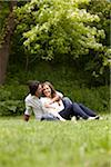 Young Couple Sitting on Grass in Park Stock Photo - Premium Royalty-Free, Artist: Ikonica, Code: 600-05786146