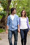Young Couple Walking through Park Stock Photo - Premium Royalty-Free, Artist: Ikonica, Code: 600-05786149