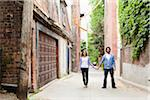 Portrait of Young Couple Standing in Alleyway, Toronto, Ontario, Canada Stock Photo - Premium Royalty-Free, Artist: Ikonica, Code: 600-05786155