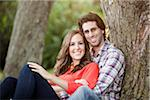 Portrait of Young Couple Sitting in Park Stock Photo - Premium Royalty-Free, Artist: Ikonica, Code: 600-05786159