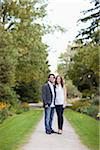 Portrait of Young Couple Standing on Walkway in Park, Ontario, Canada Stock Photo - Premium Royalty-Free, Artist: Ikonica, Code: 600-05786161
