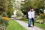 Portrait of Young Couple Standing on Walkway in Park, Ontario, Canada Stock Photo - Premium Royalty-Free, Artist: Ikonica, Code: 600-05786162