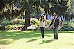 Portrait of Young Couple Standing in Park, Ontario, Canada Stock Photo - Premium Royalty-Free, Artist: Ikonica, Code: 600-05786166