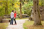 Young Couple Standing on Walkway in Park in Autumn, Ontario, Canada Stock Photo - Premium Royalty-Free, Artist: Ikonica, Code: 600-05786178