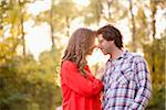 Young Couple Embracing in Park Stock Photo - Premium Royalty-Free, Artist: Ikonica, Code: 600-05786180