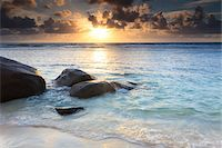 seychelles - Rocks on Beach at Sunrise, Anse Parnel, Mahe, Seychelles Stock Photo - Premium Royalty-Freenull, Code: 600-05786220