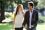 Young Couple Walking through Park Stock Photo - Premium Royalty-Free, Artist: Ikonica, Code: 600-05786464