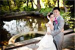 Bride and Groom near Pond Stock Photo - Premium Rights-Managed, Artist: Ikonica, Code: 700-05786444