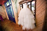 Wedding Gown Hanging in front of Mirror Stock Photo - Premium Rights-Managednull, Code: 700-05786468