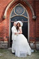 Bride and Groom Standing in front of Church Stock Photo - Premium Rights-Managednull, Code: 700-05786472