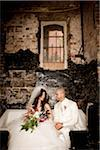 Bride and Groom Sitting Together