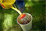 Watering Soil in Bucket, Bradford, Ontario, Canada Stock Photo - Premium Royalty-Free, Artist: Shannon Ross, Code: 600-05786555