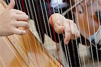 Close-Up of Harp Player's Hands Stock Photo - Premium Rights-Managednull, Code: 700-05786587