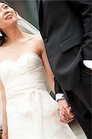 special moment - Close-up Portrait of Bride and Groom Holding Hands Stock Photo - Premium Rights-Managednull, Code: 700-05786624