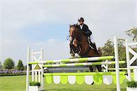 equestrian - Young Woman Horseback Rider Jumping Hurdle Stock Photo - Premium Royalty-Freenull, Code: 622-05786756