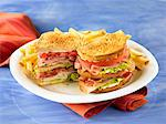 Turkey, ham, and bacon club sandwich with fries Stock Photo - Premium Royalty-Freenull, Code: 6106-05787971
