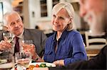 Mature woman at dinner party Stock Photo - Premium Royalty-Freenull, Code: 614-05792353