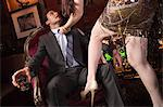 Woman grabbing businessman in bar Stock Photo - Premium Royalty-Free, Artist: Robert Harding Images, Code: 614-05792413