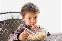 Grumpy child disappointed with his breakfast Stock Photo - Premium Royalty-Freenull, Code: 693-05793965
