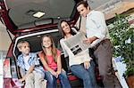 Low angle view of family sitting at back of car Stock Photo - Premium Royalty-Free, Artist: Cusp and Flirt, Code: 693-05793989