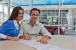 Couple signing documents for new car Stock Photo - Premium Royalty-Free, Artist: CulturaRM, Code: 693-05794014