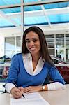 Portrait of young female signing document Stock Photo - Premium Royalty-Free, Artist: Aflo Relax, Code: 693-05794015