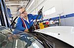 Senior mechanic working on windshield wipers Stock Photo - Premium Royalty-Free, Artist: Cusp and Flirt, Code: 693-05794056