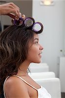 Side profile of young woman wearing curlers Stock Photo - Premium Royalty-Freenull, Code: 693-05794096