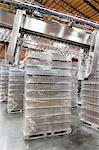 Stack of bottled water kept in warehouse Stock Photo - Premium Royalty-Freenull, Code: 693-05794203
