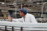 Factory worker examining bottled water Stock Photo - Premium Royalty-Freenull, Code: 693-05794209
