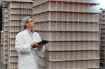 Man inspecting bottled water in distribution warehouse Stock Photo - Premium Royalty-Freenull, Code: 693-05794240