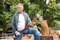 forestry - Senior lumber jack holding an axe and looking away Stock Photo - Premium Royalty-Freenull, Code: 693-05794381