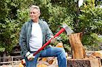 Senior lumber jack holding an axe and looking away Stock Photo - Premium Royalty-Free, Artist: Ron Fehling, Code: 693-05794381