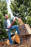 Low angle view of man holding an axe Stock Photo - Premium Royalty-Freenull, Code: 693-05794382