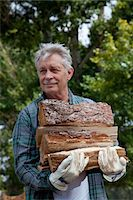 forestry - Senior man carrying firewood Stock Photo - Premium Royalty-Freenull, Code: 693-05794384