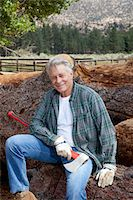 forestry - Portrait of lumberjack sitting on a pile of logs Stock Photo - Premium Royalty-Freenull, Code: 693-05794387