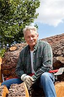 forestry - Portrait of smiling senior man sitting on logs Stock Photo - Premium Royalty-Freenull, Code: 693-05794389